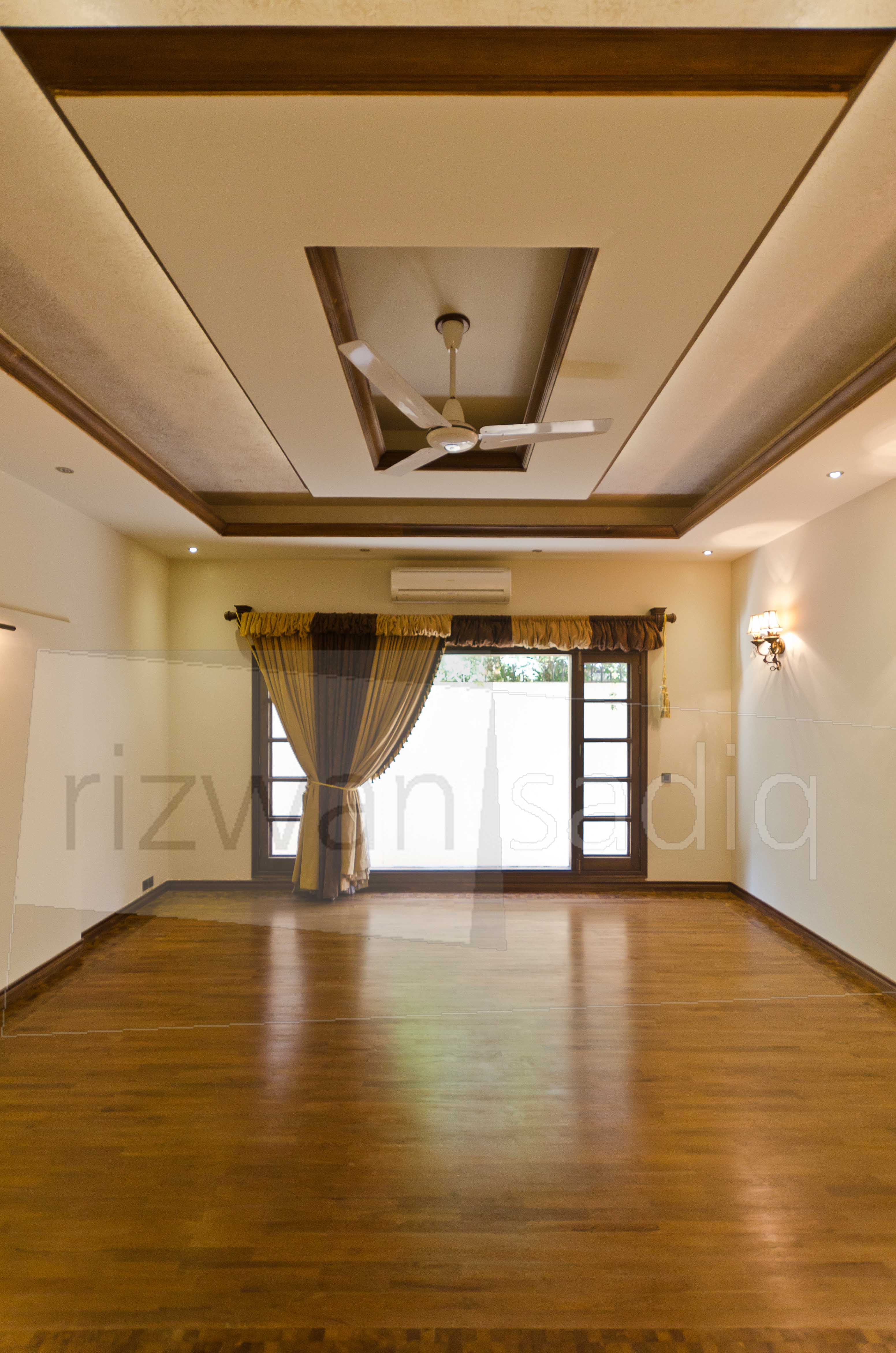 Ceiling Design And Large Windows Extend Our Visual Senses Bringing Forth A Modern Adaptability Of The Theme